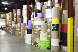 At WCI, rolls of paper stacked in the warehouse at Wisconsin Converting, Inc.